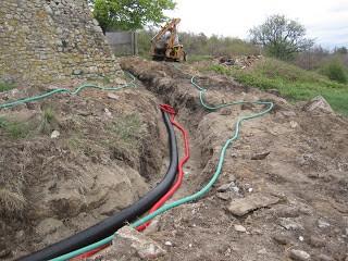 Petit réseau de chaleur enterré à la ferme de Tallans à Rompon